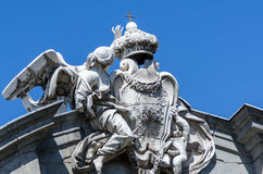 Facade of a building with sculptures on sky background in Madrid Royalty Free Stock Photography