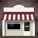 Facade of the building shop with a signboard and a showcase. Royalty Free Stock Image