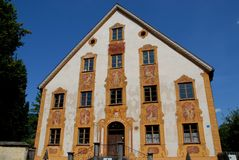 Facade of building with thirteen windows and a door in Oberammergau in Germany Stock Image