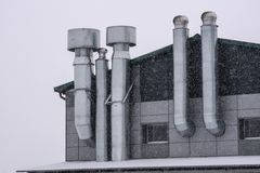 Facade of the building with ventilation in the winter stock photo