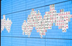 Mahjong wall. The facade of the building is a wall decorated with mahjong tiles stock photography