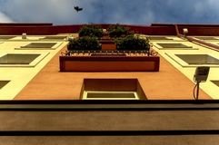 He facade of the building with windows, and balconies and other decorative elements. Bottom view Stock Photography