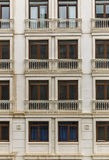 Facade of a building with windows and balconies Stock Photography