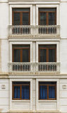 Facade of a building with windows and balconies Stock Photo