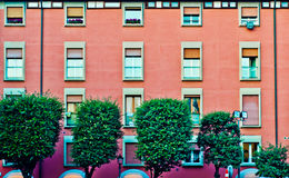 Facade of a building. With windows in Bologna Italy Stock Photo