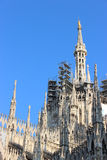 Facade buttresses - Milan Cathedral. Spires, pinnacles, and statues, with decorated flying buttresses Royalty Free Stock Photos