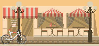 The facade of the cafe with umbrellas, chairs, tables Royalty Free Stock Photography