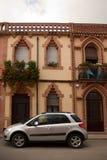 Facade and car Colonia Guell Catalonia royalty free stock photos
