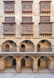 Facade of caravansary of Bazaraa, with vaulted arcades and windows covered by interleaved wooden grids mashrabiyya, Cairo, Egypt. Facade of caravansary Wikala of Stock Photography