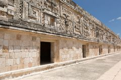 Facade carvings at the prehispanic town of Uxmal. Rich facade carvings at the prehispanic town of Uxmal , a Unesco World Heritage site Stock Image