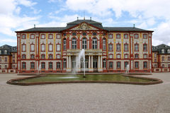 Facade of castle with fountain. Gothic castle with basin, Germany stock photo
