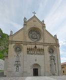 Facade of the Cathedral of Gemona with a statue of side Royalty Free Stock Photography