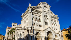 Facade of cathedral in Monaco on blue sky background Stock Photos