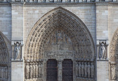 Facade of the cathedral Notre Dame de Paris. PARIS, FEBRUARY 15 : facade of the cathedral Notre Dame de Paris on FEBRUARY 15, 2013 in Paris, France Royalty Free Stock Image