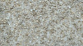 Facade cement plaster with fine gravel. Hardened concrete mass. Grey stone wall stock photos