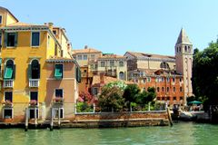 Facade and channel in Venice (Venezia, Vinegia,Venexia, Venetiae). Venice has beautiful cityscape, uniqueness, and rich musical and artistic cultural heritage Stock Photography