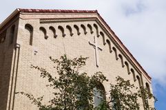 Facade of church. The facade of a church with the Christian cross Royalty Free Stock Images