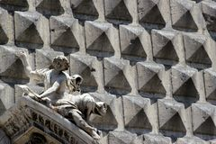 The facade of the church of the Gesu', Naples, Italy. Concrete wall of Naples' church Royalty Free Stock Photography