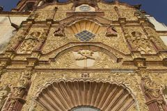 Facade of the Church of Jalpan. The admirable facade of parish of Santiago Apostol in Jalpan de Serra, state of Queretaro in Mexico, relief made of stucco and royalty free stock photography