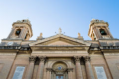 Facade of Church of Our Lady of Victories Senglea Basilica. Malta, Senglea - 10 Jan 2016: Facade of Church of Our Lady of Victories Senglea Basilica low angle Royalty Free Stock Photography