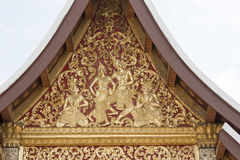 The facade of the church roof Wood carving . Stock Photo