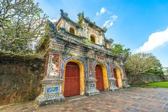 Beautiful gate to Citadel of Hue in Vietnam, Asia. Facade of Citadel gate in Hue, Vietnam, Asia. Ornate entrance to Hue Imperial City. Bright day with blue sky stock image