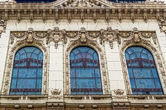 Facade on classical building with ornaments and sculptures Stock Photos