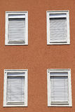 Facade with closed windows. Brown facade with closed windows Royalty Free Stock Photos