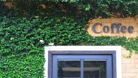 Facade of coffee shop with climber and CCTV camera Stock Photos