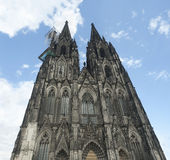 Facade of Cologne Cathedral in Germany. Stock Image