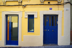 Facade with colours. Wall and doors painted of colours Stock Images