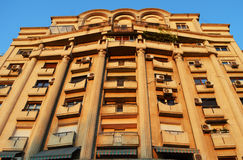 Facade of communist-era apartment block, Bucharest, Romania. The facade of a Ceausescu-era apartment block in Bulevardul Libertatii, Bucharest, Romania, glows in stock image