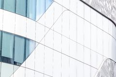 The facade consists of glass and aluminum composite. In the city royalty free stock images