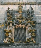 Facade of the Convent of Christ with its famous intricate Manueline window in medieval Templar castle in Tomar, Portugal.  royalty free stock photos