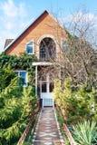 Facade of country house in autumn. Facade of country house in sunny autumn day Royalty Free Stock Photography