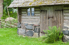 Facade of countryside wooden log house Stock Photography