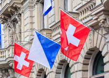 Facade of the Credit Suisse building, decorated with flags Stock Photos