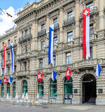 Facade of the Credit Suisse building, decorated with flags Stock Image
