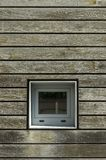Facade cutout with wooden paneling and small square window. Back. Ground royalty free stock photography
