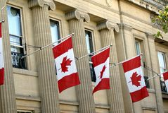 Facade decorated with the Canada flags or maple leaf flag Stock Photo