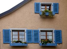 Blue Windows with flowers Staufen im Breisgau Schwarzwald germany. Facade decorated with flowers in Staufen im Breisgau Schwarzwald Germany stock photography