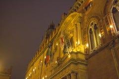 Facade detail of Palazzo d`Accursio at Piazza Maggiore by night. Bologna. Emilia-Romagna region. Italy. Stock Images