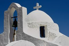 Facade detail of the traditional greek chapel with white plastered walls stock photography