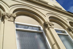 Facade details of arched windows and columns Royalty Free Stock Images