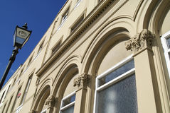 Facade details of arched windows , columns, and street lamp post Royalty Free Stock Image