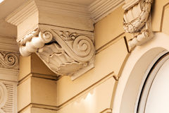 Facade details. Stone facade on classical building with ornaments and sculptures Royalty Free Stock Photos