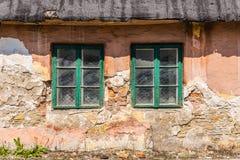 Facade of a dilapidated house Stock Photos