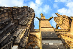Facade of the Dom church in the city Cologne lit by sun Stock Photography