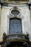 Facade of the Dominican Cathedral, Lviv, Ukraine. Fragment  window with metal gril and balcony. Close up. Stock Photo