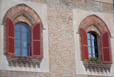 Facade element, with two windows, in an old building in the city center in Lodi in Lombardy (Italy Royalty Free Stock Image